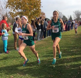 Gabby Skopec '17 (left) and Bailey Nock '18 (right) run together  at the Iowa State Meet on October 29.