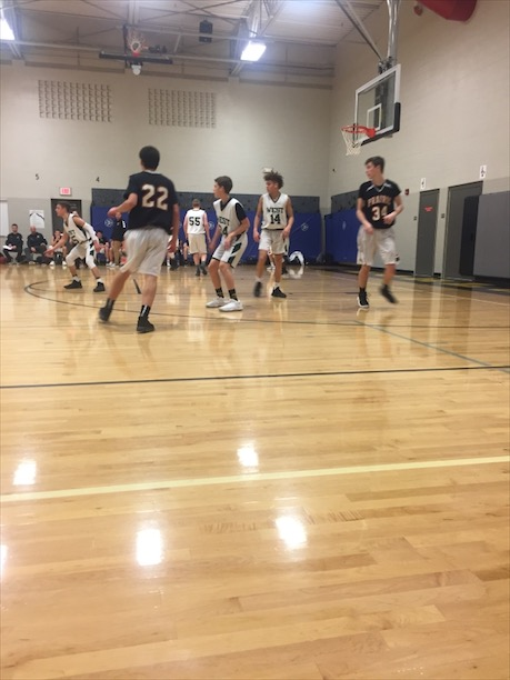 Tyuss Bell '21, Zach Anderson '21, Luke Arens '21,  and Luke Miller '21 play defense vs Cedar Rapids Prairie on January 8th, 2018.