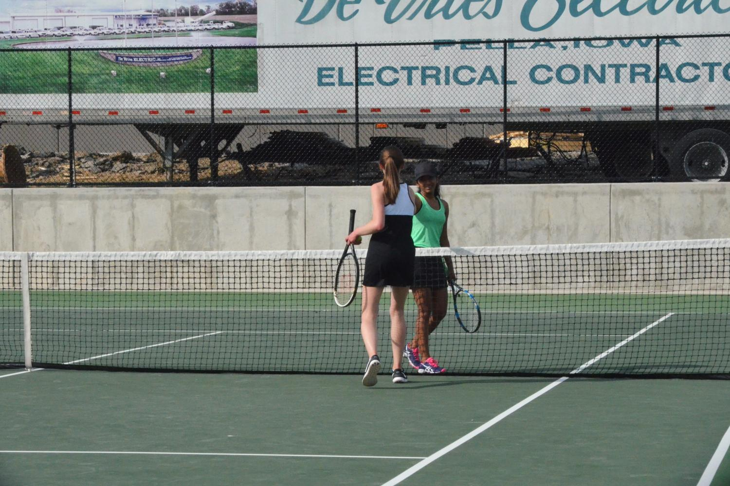 Jessica Moonjely '20 shakes hands with her opponent, after winning her singles match.
