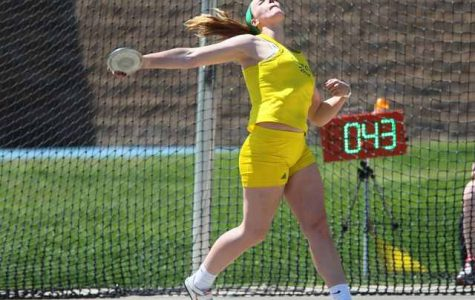 Haight participates in discus during a track meet