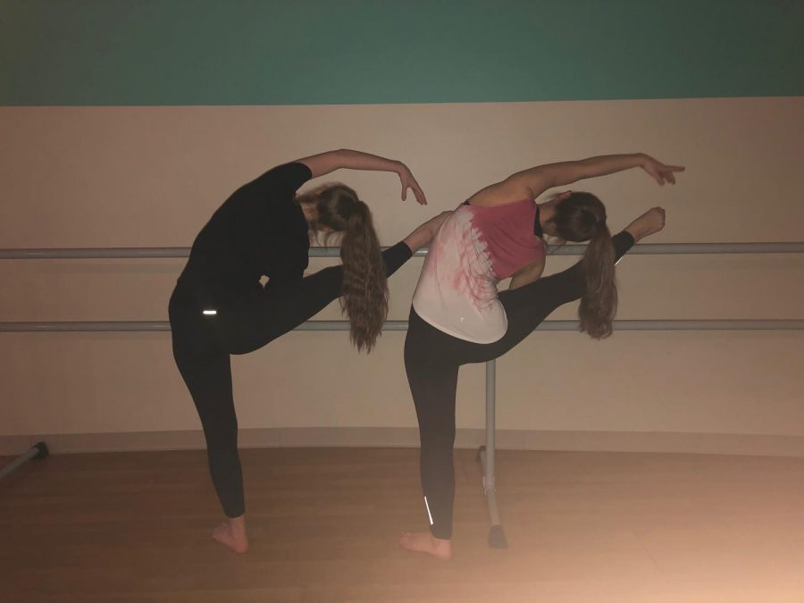 Abby Cupp '22 and Amelia Cleary '22 stretch at the bar before a couple more dance classes left of the day.