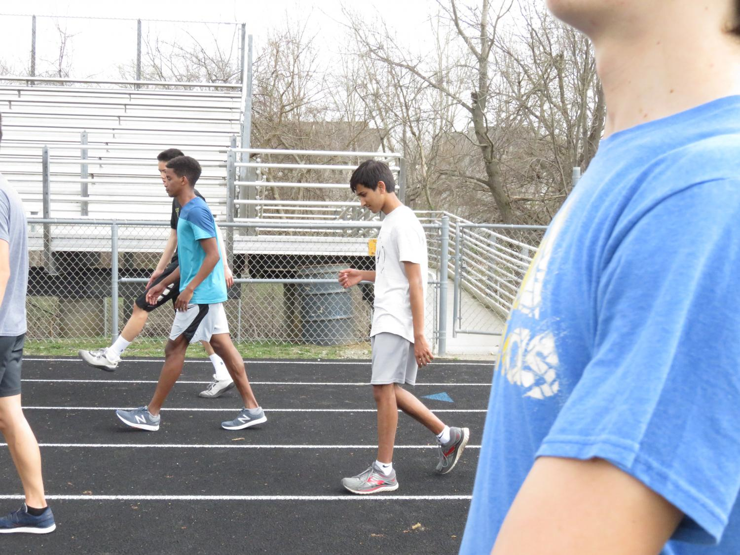 Mohan Kumar '21 recollects while he stretches at track practice.