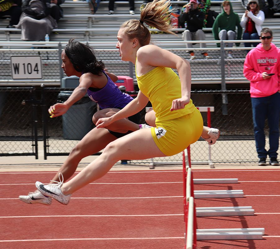 Peyton Steva '19 races toward the finish line through the hurdles head-to-head with Liberty