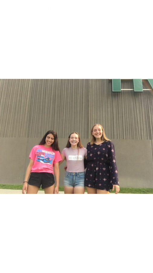 Jasmine poses with friends in front of West High.