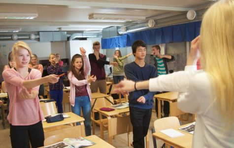 Finland's schools take a more interactive approach, such as this Finnish high school class.