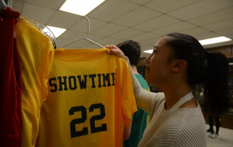 """After the West High show choirs' open rehearsal on January 23rd, Alyssa Hagiwara '23 hangs up her Showtime jersey. """"I love being in Showtime because I get to do the three things I love most: singing, dancing, and being with my amazing friends,"""" she says. (Feature)"""