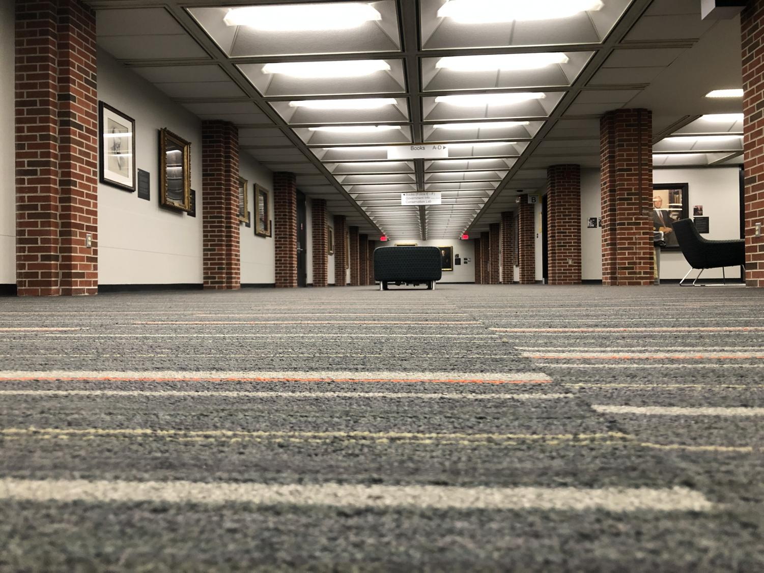 On+a+saturday+night%2C+surprisingly+the+university+library+is+barely+busy+and+some+floors+are+completely+empty.+From+the+worm%27s+eye+view+you+can+really+appreciate+the+leading+pillars+and+ceiling+tile+as+well+as+the+art+filling+the+walls.+%28worm%27s+eye+view%29%0A