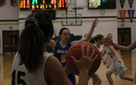 Tamiah Teran '23 throws the ball in bounds from the sidelines