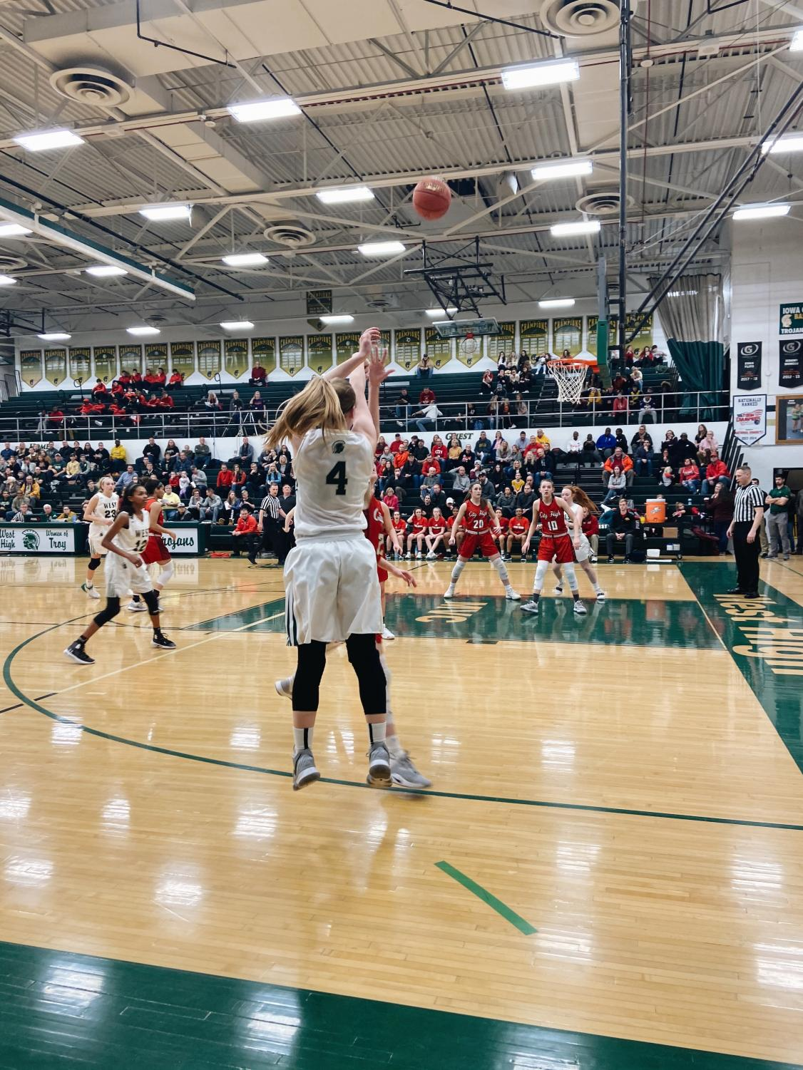 Anna+Prouty+%E2%80%9823+%28%234%29+attempts+a+three-point+shot+at+this+year%E2%80%99s+home+game+against+City%E2%80%99s+Varsity+Girls+Basketball+Team.+%28event+action+%231%29%0A%0A