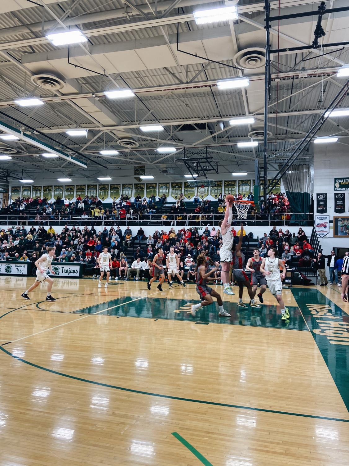 Even+Brauns+%28%2334%29+dunks+against+City%27s+Varsity+Boys+Basketball+Team+during+this+year%27s+City-West+home+game.+%28event+action+%232%29