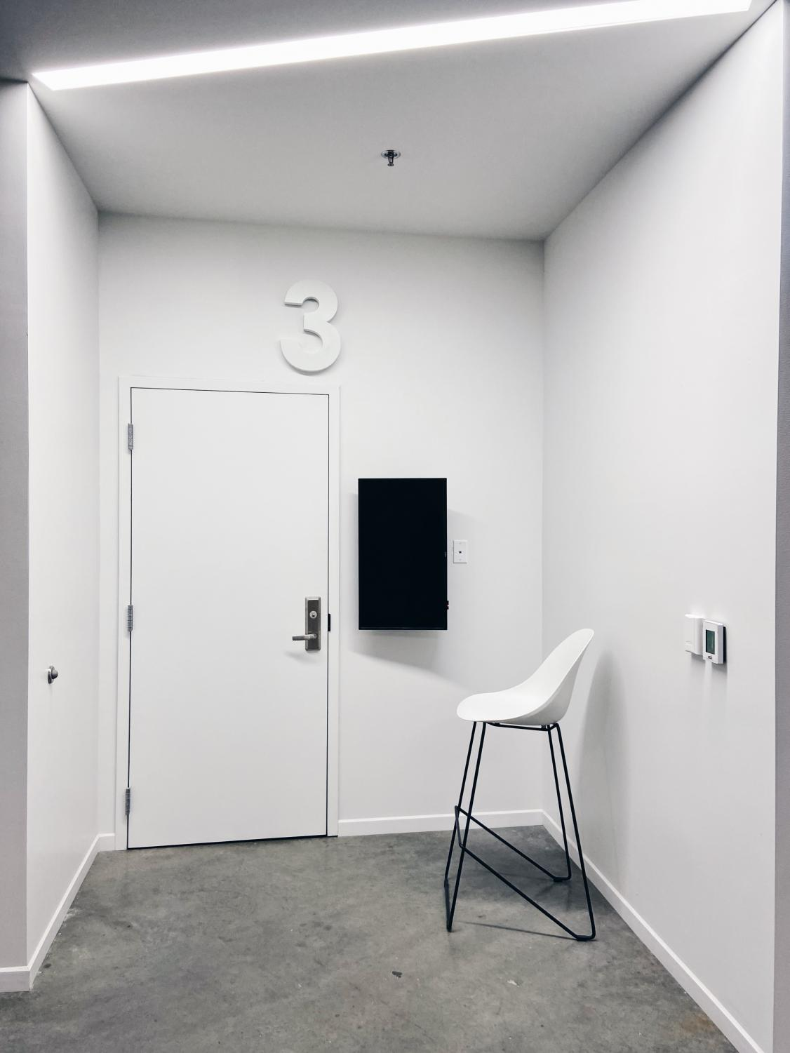 Narrow+white+walls+frame+this+monochromatic+entryway+at+The+Chauncey+Hotel.+%28free+form%29