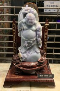This picture displays the Laughing Buddha. The Laughing Buddha is always shown laughing or smiling, hence his nickname, Laughing Buddha.