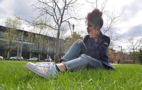 Emina Abdagic '17 lays in the grass in downtown Iowa City to enjoy the warm weather.