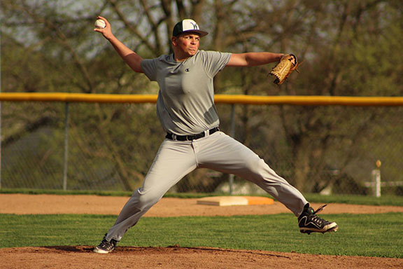 Nathan Wilkinson 19 throws a pitch