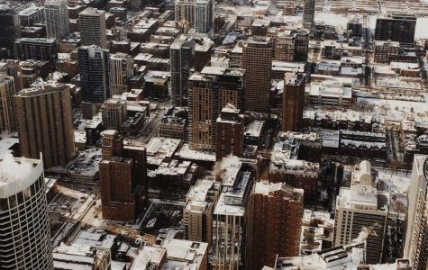 Feature: On a quiet afternoon, the striking skyscrapers of Chicago continue to rise high on a snowy winter day, continuing to show off the beauty of this well-known busy city.