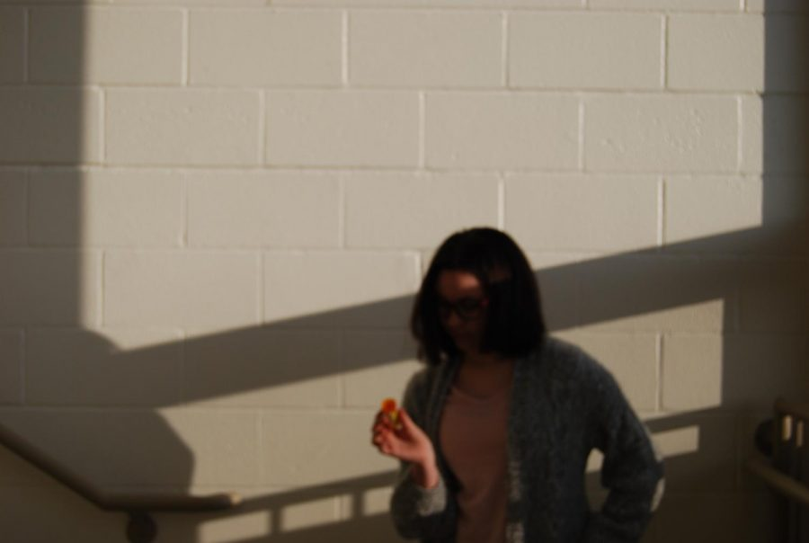 Featured Photo - Hana Abou Alaiwa '23 wanted to take a picture with a random object and found an empty medicine bottle.