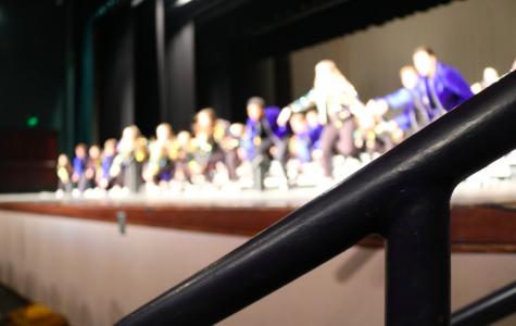 Light: The GTC show choir's dresses sparkle under the stage light.