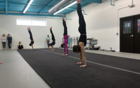 Feature/Event(Action)-- Students of Nolte Academy take on a hand-stand contest during their Acrobatics class on Saturday, January 18th.