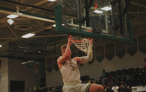 Even Brauns '20 dunks the ball into the hoop. (Feature image)