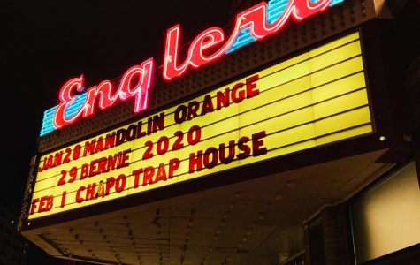 Pedestrians enter the Englert Theatre for an evening performance by Mandolin Orange. (Vivian Maier inspired)